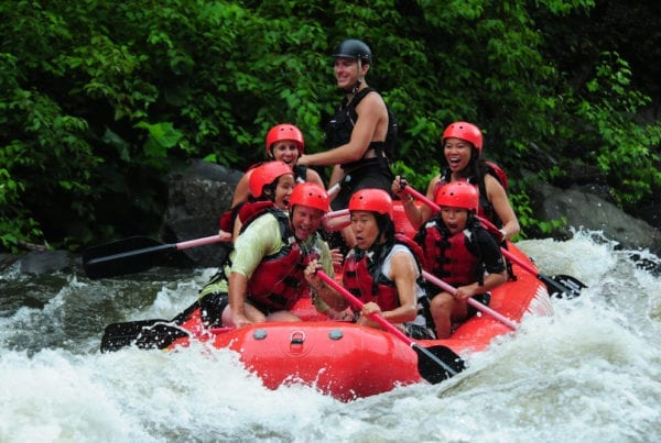 A family white water rafting with Smoky Mountain Outdoors.