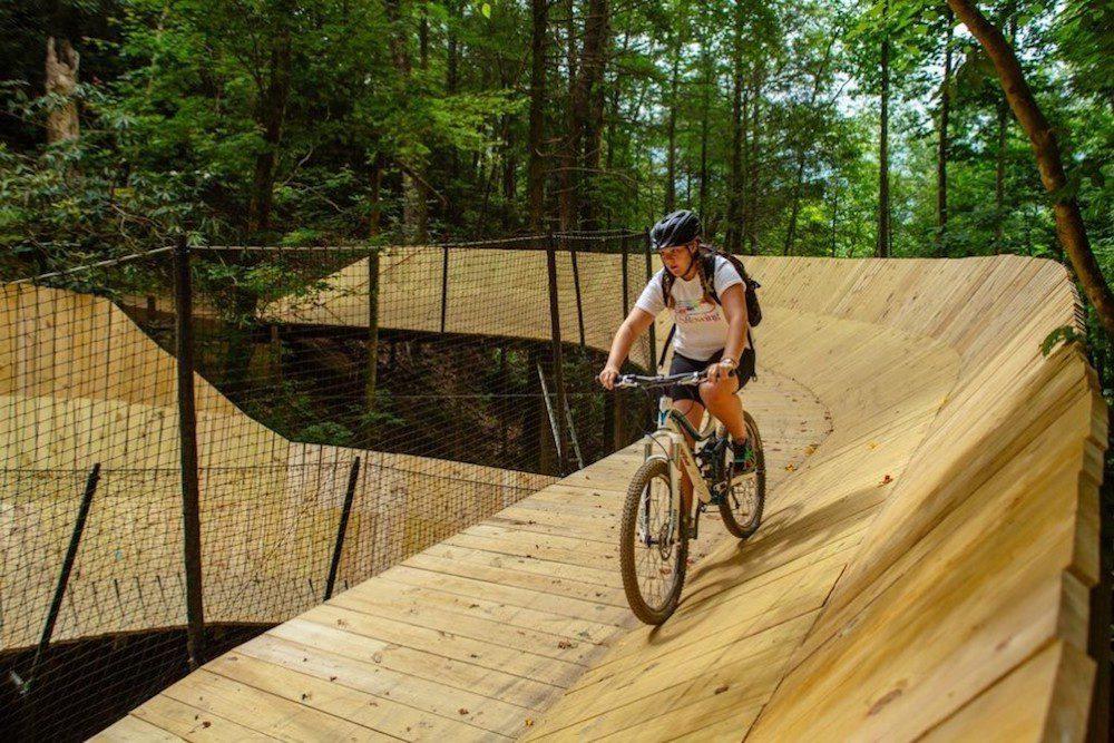 A girl mountain biking in Gatlinburg on The Curliest.