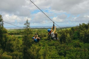 A happy couple taking an Oahu zipline adventure.
