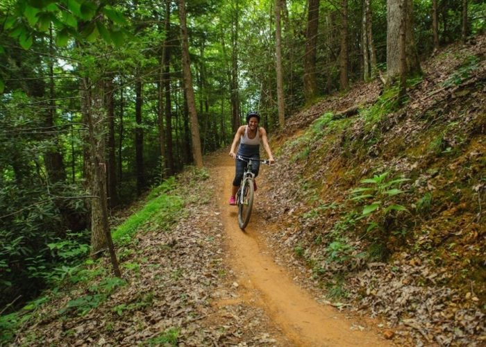A woman mountain biking in Gatlinburg at CLIMB Works.