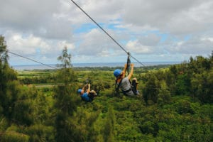 A couple ziplining together in Oahu.