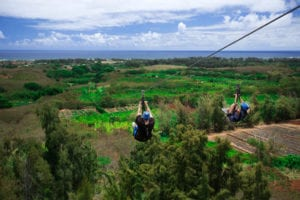 A man and a woman enjoying our Oahu zipline course.