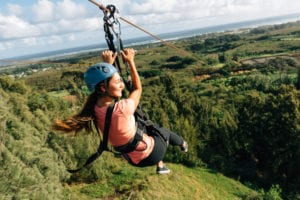 A young woman enjoying one of our ziplines in Oahu.