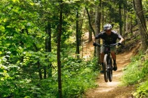 man mountain biking in the smoky mountains
