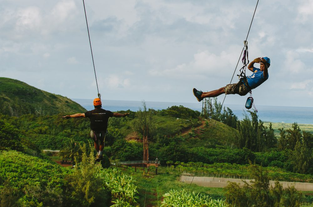 Two men ziplining in Oahu.
