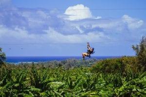 woman ziplining in oahu