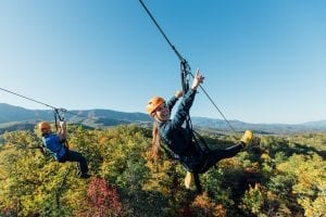 friends on mountaintop zipline tour climb works