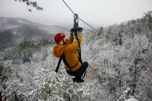 woman ziplining in the winter