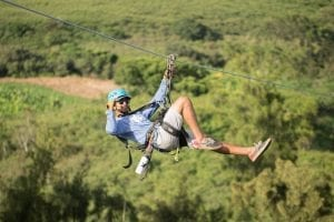 man ziplining in oahu