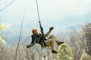 guy ziplining in Smoky Mountains