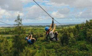 people ziplining in Oahu