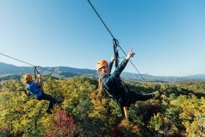 guy and girl ziplining