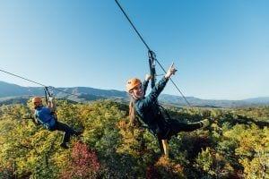 guy and girl ziplining