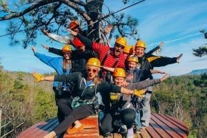 group of friends ziplining in the smoky mountains